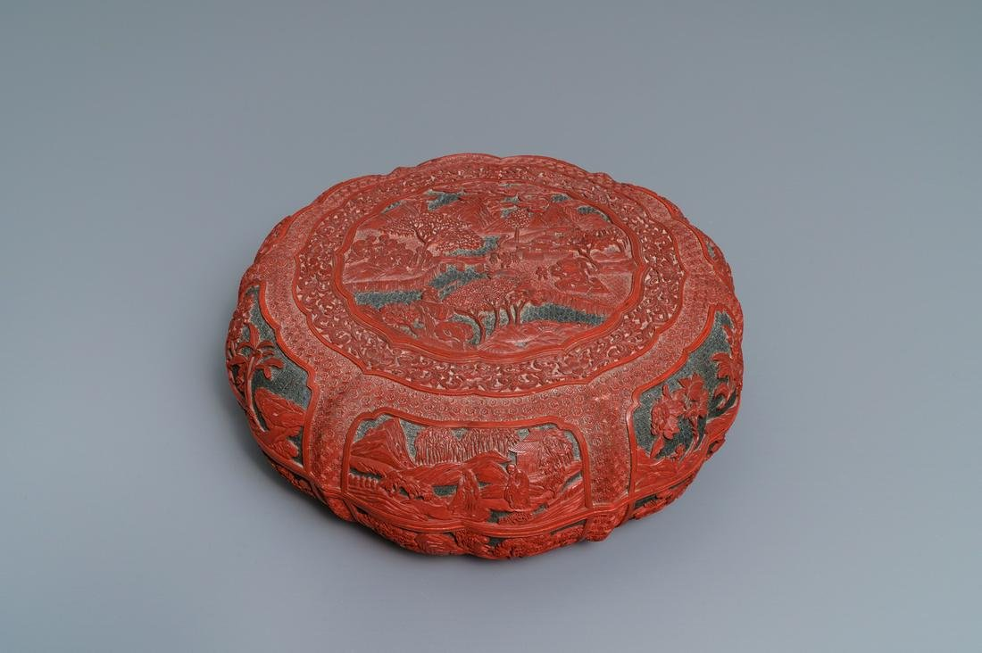 A Chinese cinnabar lacquer box and cover with figures