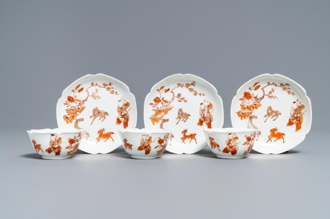 Three Chinese iron red eggshell cups and saucers with