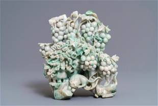 A Chinese jadeite carving of two cats among grapes and