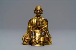A SinoTibetan gilt bronze figure of a Lama 19th C