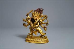 A SinoTibetan gilt bronze group of Mahakala and his