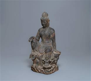 A large Chinese cast iron figure of Guanyin with