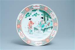 A large Chinese famille verte dish with ladies and boys