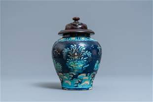 A Chinese fahua vase with mandarin ducks in a lotus