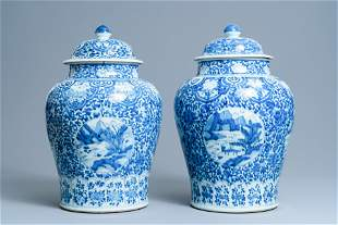 A pair of Chinese blue and white covered vases with