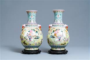 A pair of Chinese famille rose vases, Qianlong mark,