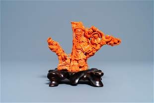 A Chinese carved red coral 'immortal' group, 19/20th C.