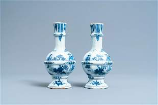 A pair of Dutch Delft blue and white chinoiserie vases,