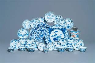 Eighteen Chinese blue and white saucers, seven cups,