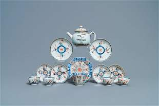 A Chinese famille verte teapot, seven saucers and five