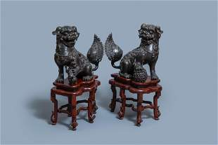 A pair of large Chinese bronze Buddhist lions, Ming
