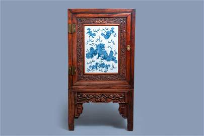 A Chinese hongmu cupboard with a blue and white