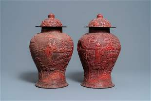 A pair of Chinese red cinnabar lacquer vases and