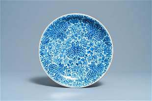 A Chinese blue and white dish with floral design,