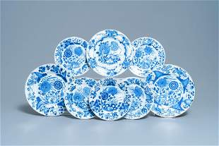 Eight Chinese blue and white plates with birds among