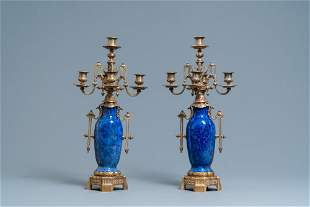 A pair of Chinese blue-ground vases with bronze