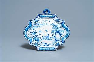 A Dutch Delft blue and white chinoiserie plaque, 18th