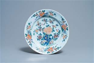 A polychrome Dutch Delft dish with fine floral design,