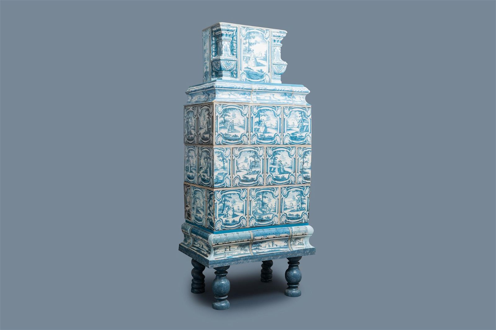 A composite stove with blue and white stove tiles,