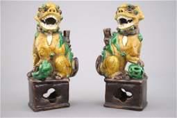 A pair of Chinese sancai glazed pottery Buddhist lion