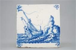 A Dutch Delft tile with a ship near rocks late 17th C