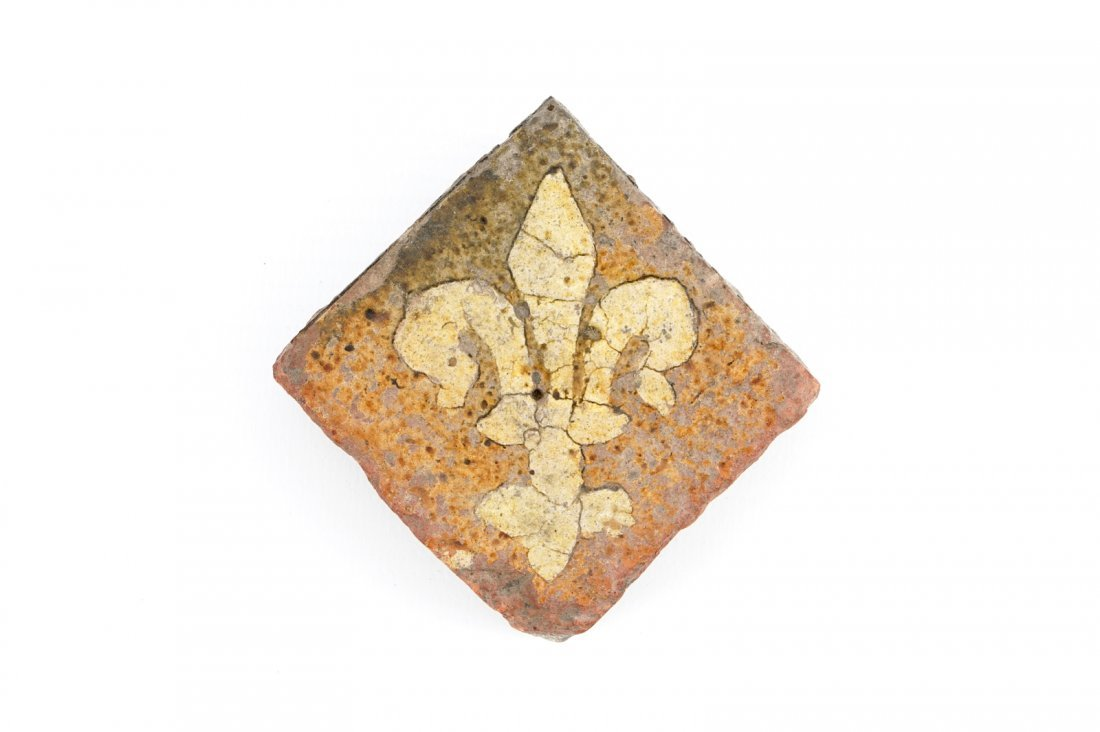 A medieval tile with a Fleur-de-Lys, probably