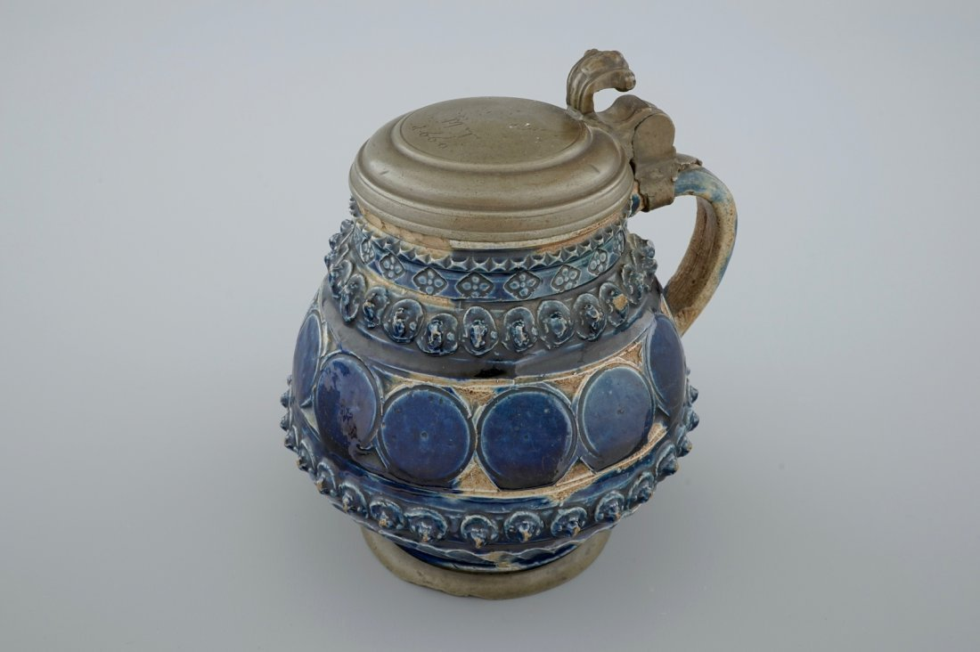 A pewter-mounted Muskau stoneware stein, dated 1660