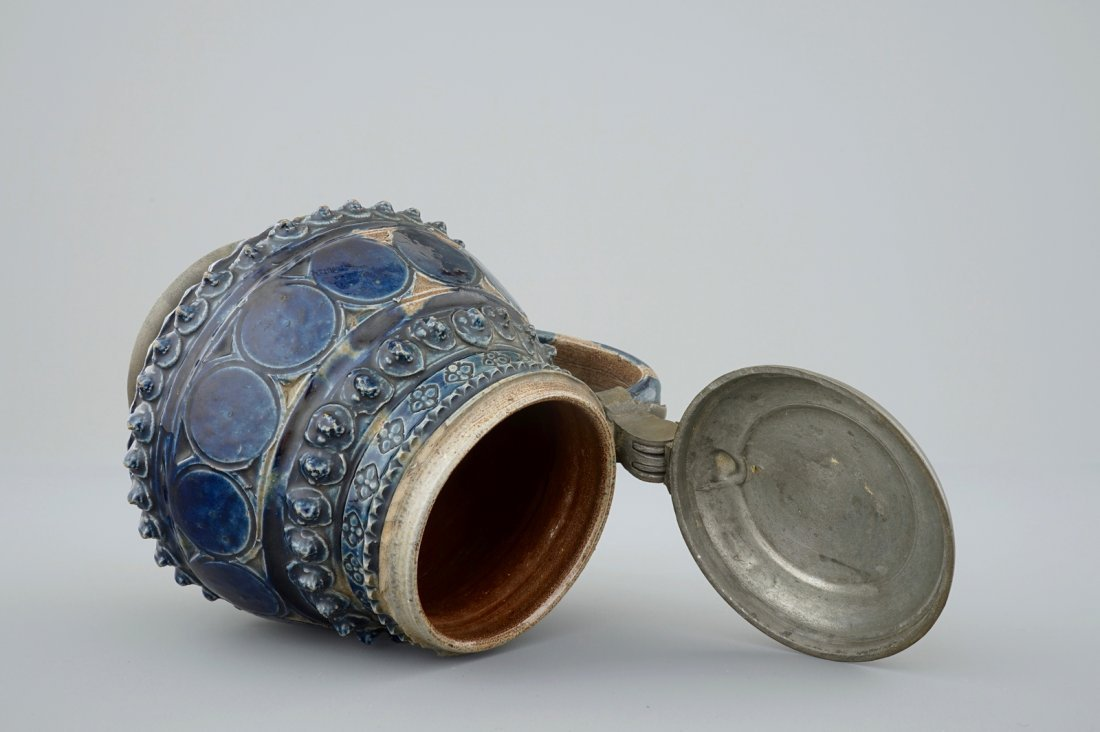 A pewter-mounted Muskau stoneware stein, dated 1660 - 7