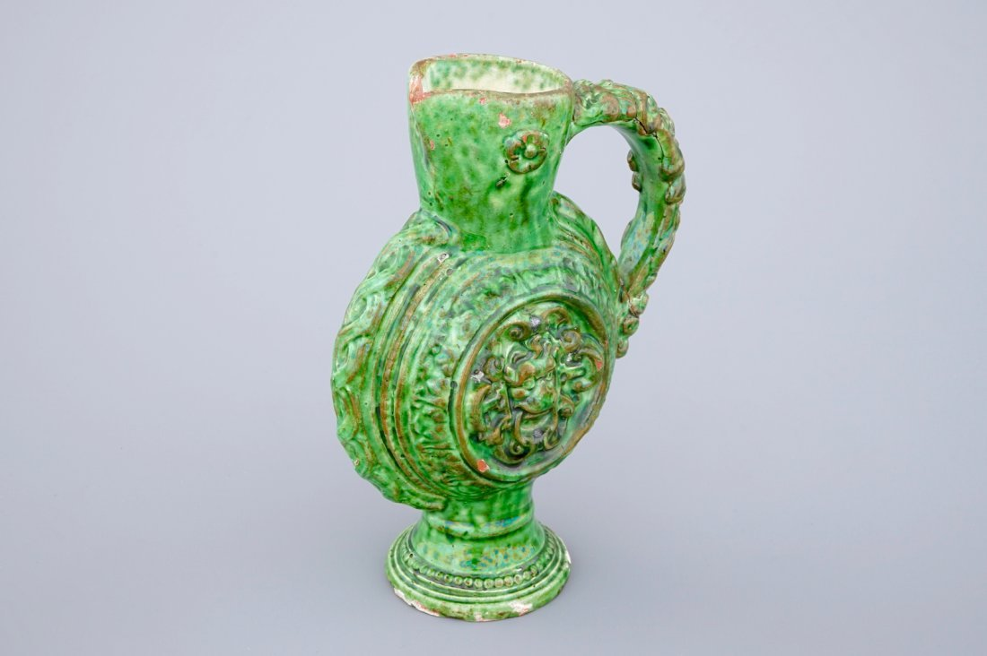 A green glazed Saintonge relief decorated jug,