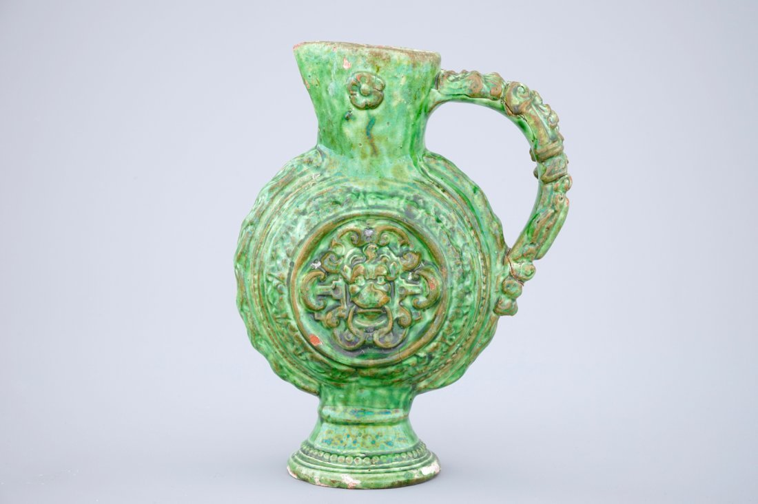 A green glazed Saintonge relief decorated jug, - 2
