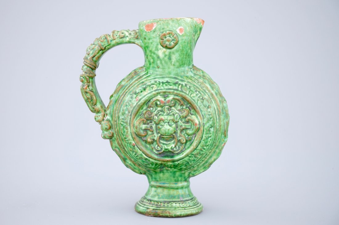 A green glazed Saintonge relief decorated jug, - 4