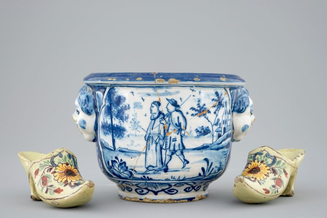 A pair of Dutch Delft polychrome pottery shoes and a