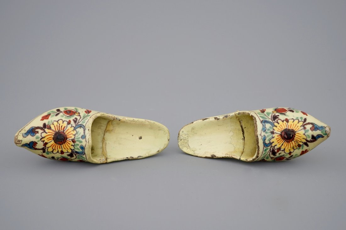 A pair of Dutch Delft polychrome pottery shoes and a - 2
