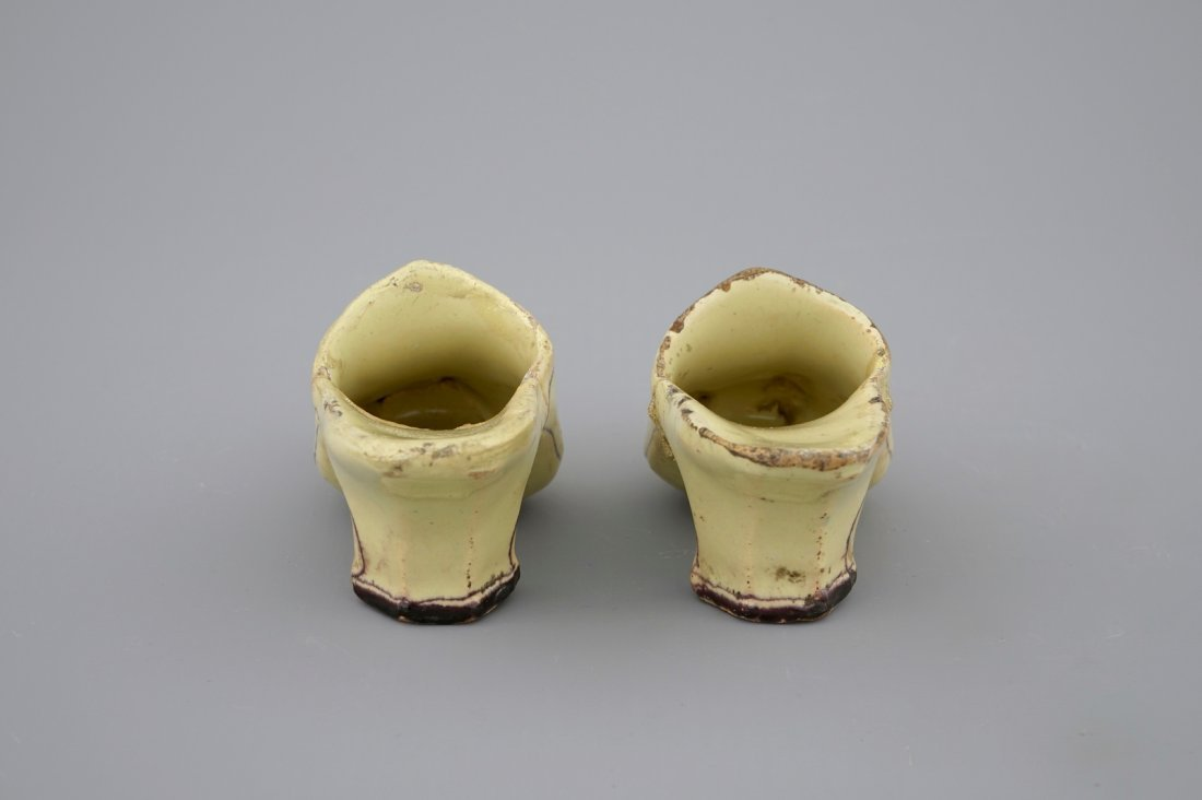 A pair of Dutch Delft polychrome pottery shoes and a - 6