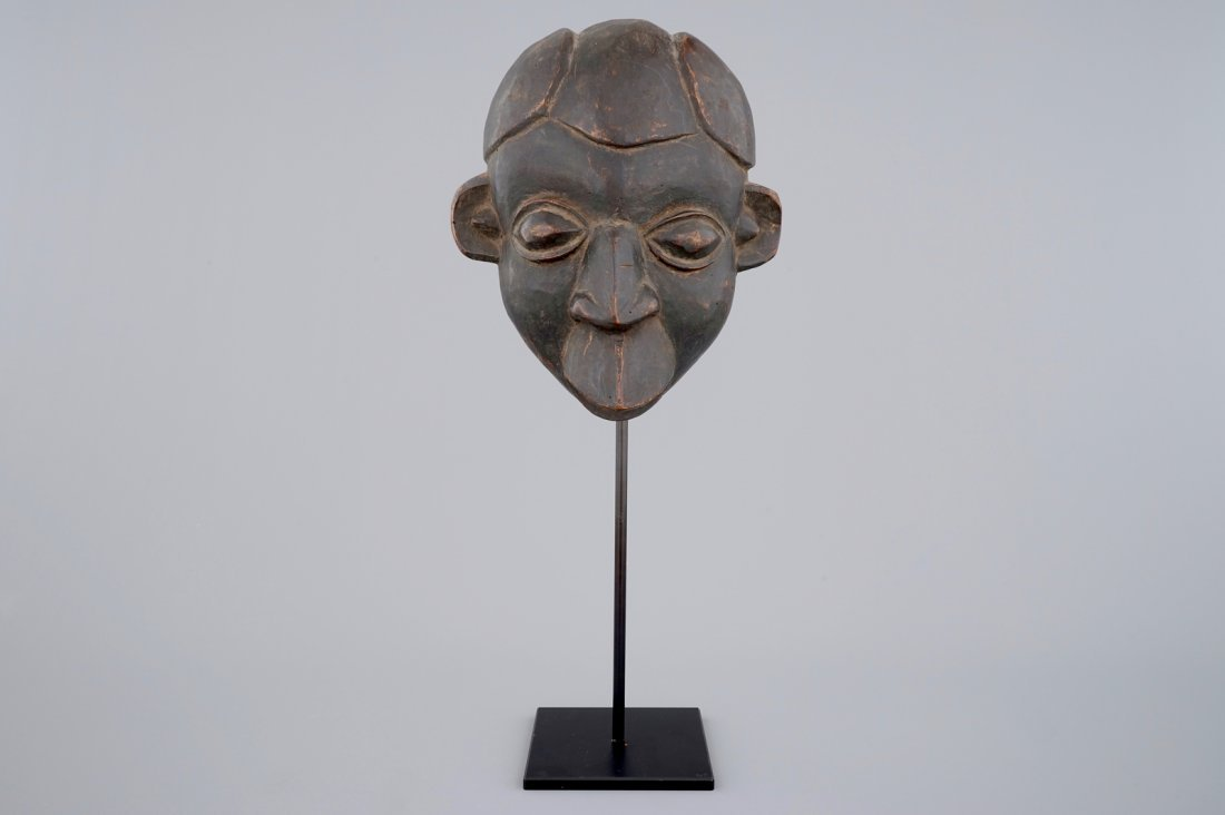 An African carved wooden mask, Bamum, Cameroon
