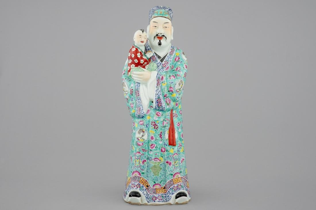 A large Chinese famille rose figure of an immortal,