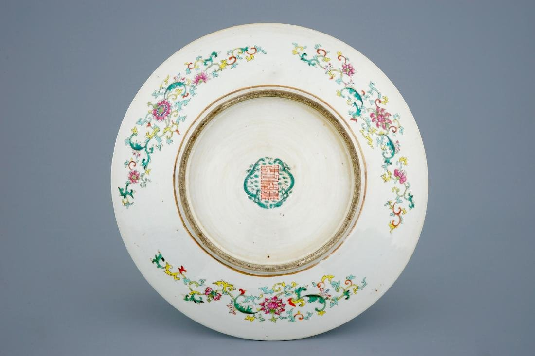A Chinese turquoise ground famille rose charger with - 2