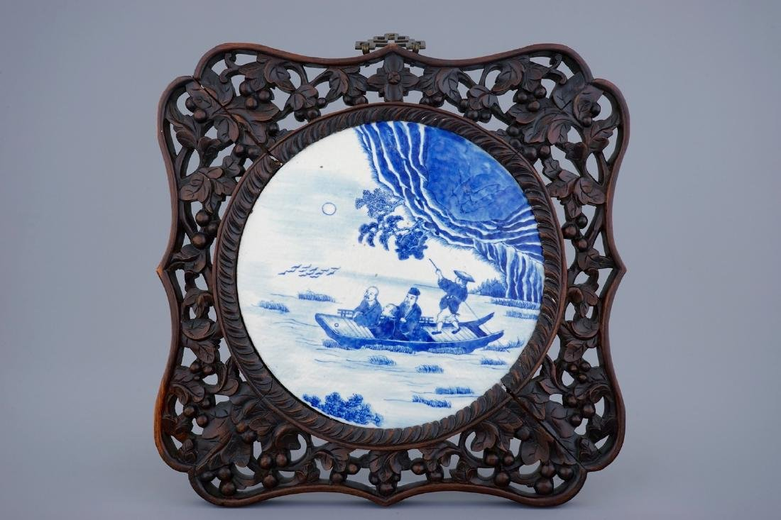 A Chinese blue and white plaque in sculpted frame, 19th