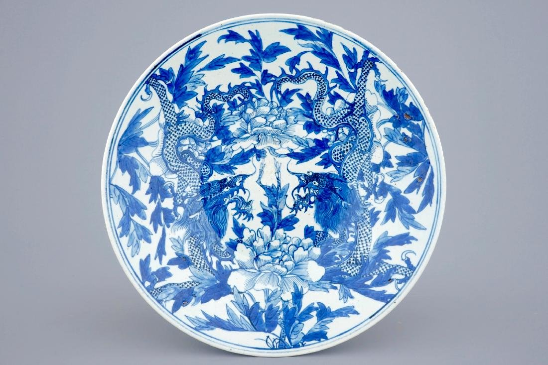A blue and white Chinese dish with dragons among peony,