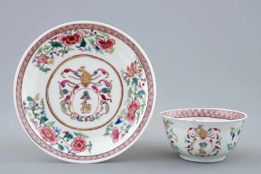 A Chinese famille rose armorial cup and saucer for the