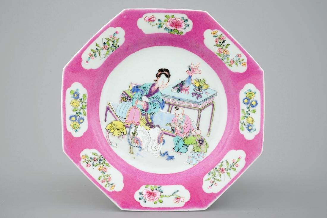 A Chinese octagonal famille rose dish with pink border,