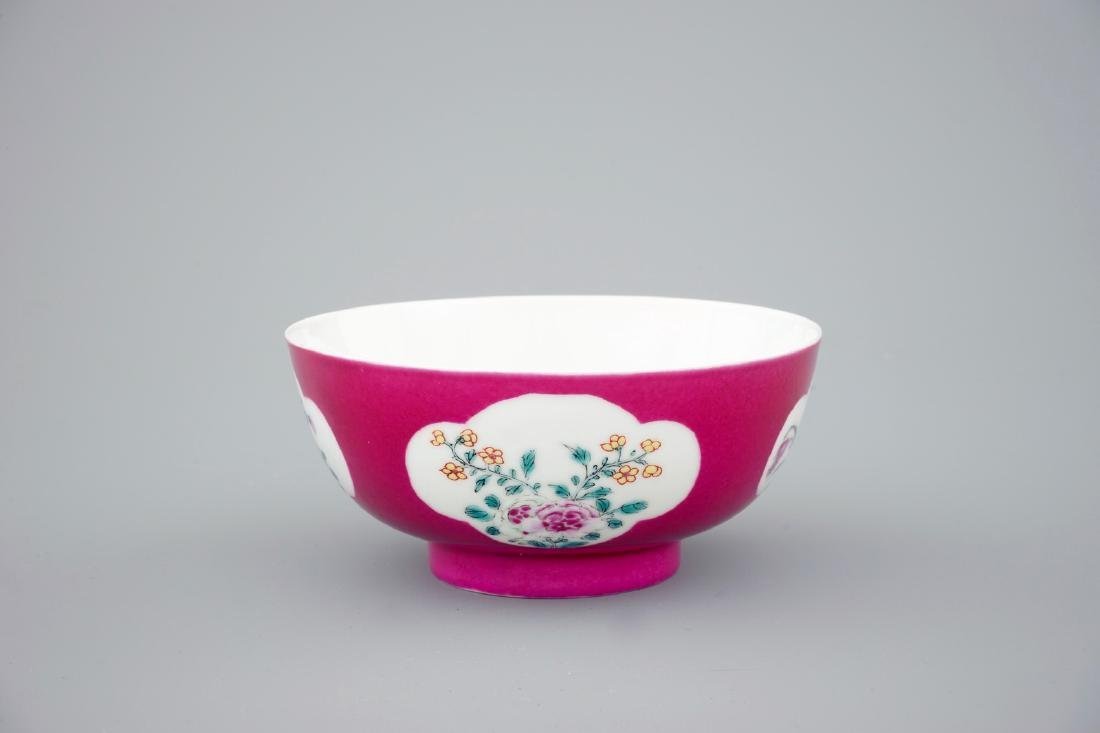 A Chinese ruby ground bowl with floral reserves in
