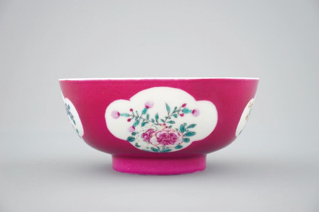 A Chinese ruby ground bowl with floral reserves in - 2