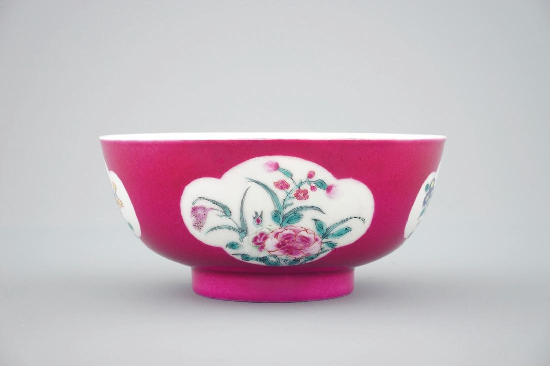 A Chinese ruby ground bowl with floral reserves in - 4
