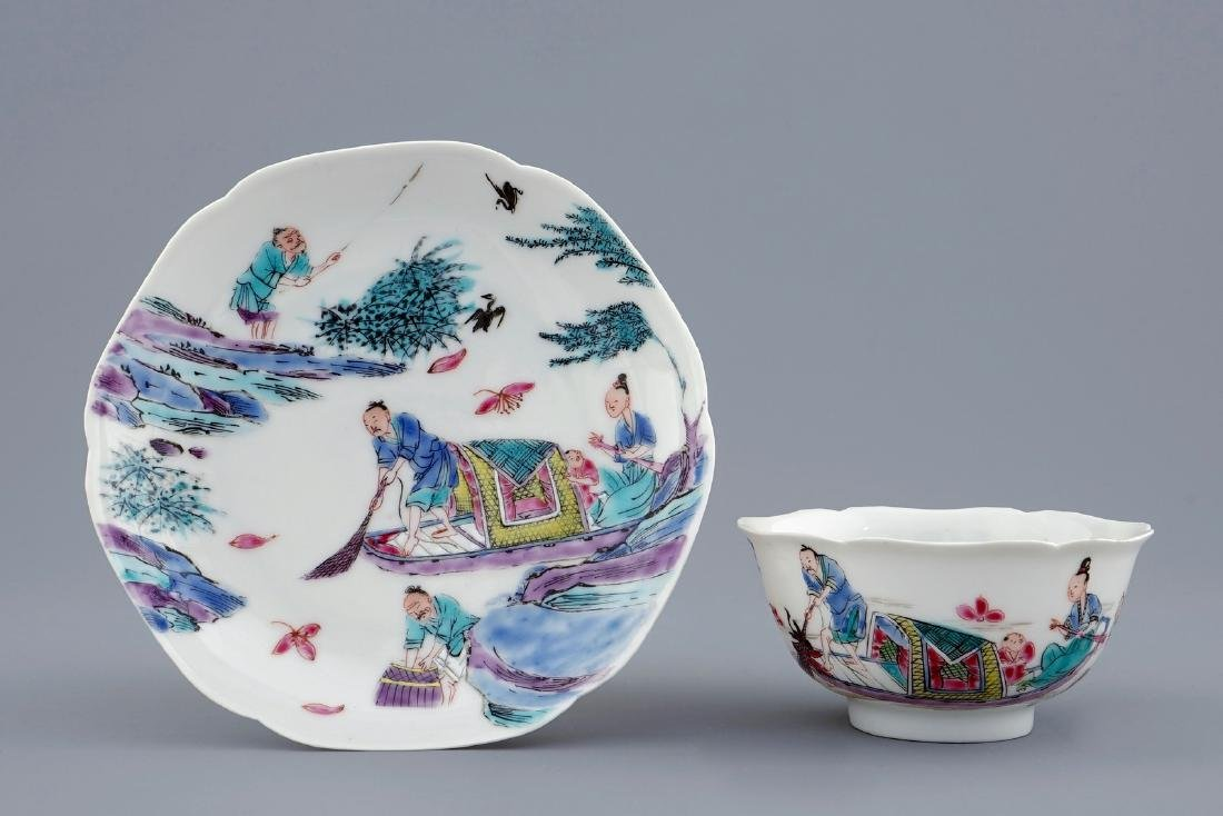 A Chinese famille rose cup and saucer with a fishing