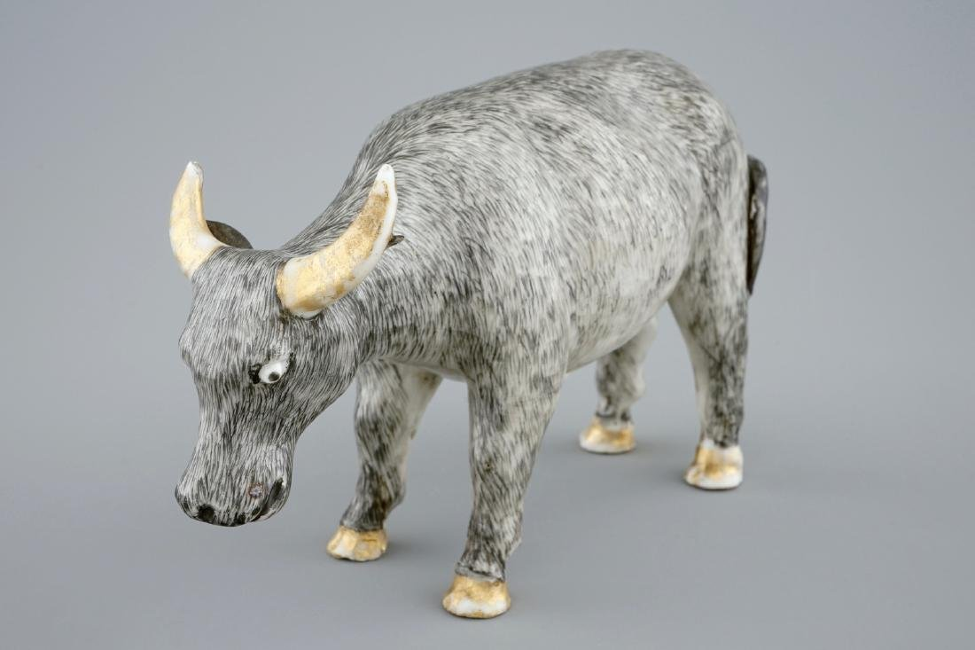An unusual Chinese grisaille and gilt model of an ox,