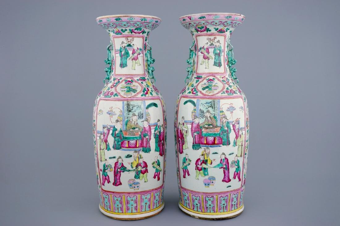 A tall pair of Chinese famille rose vases with court