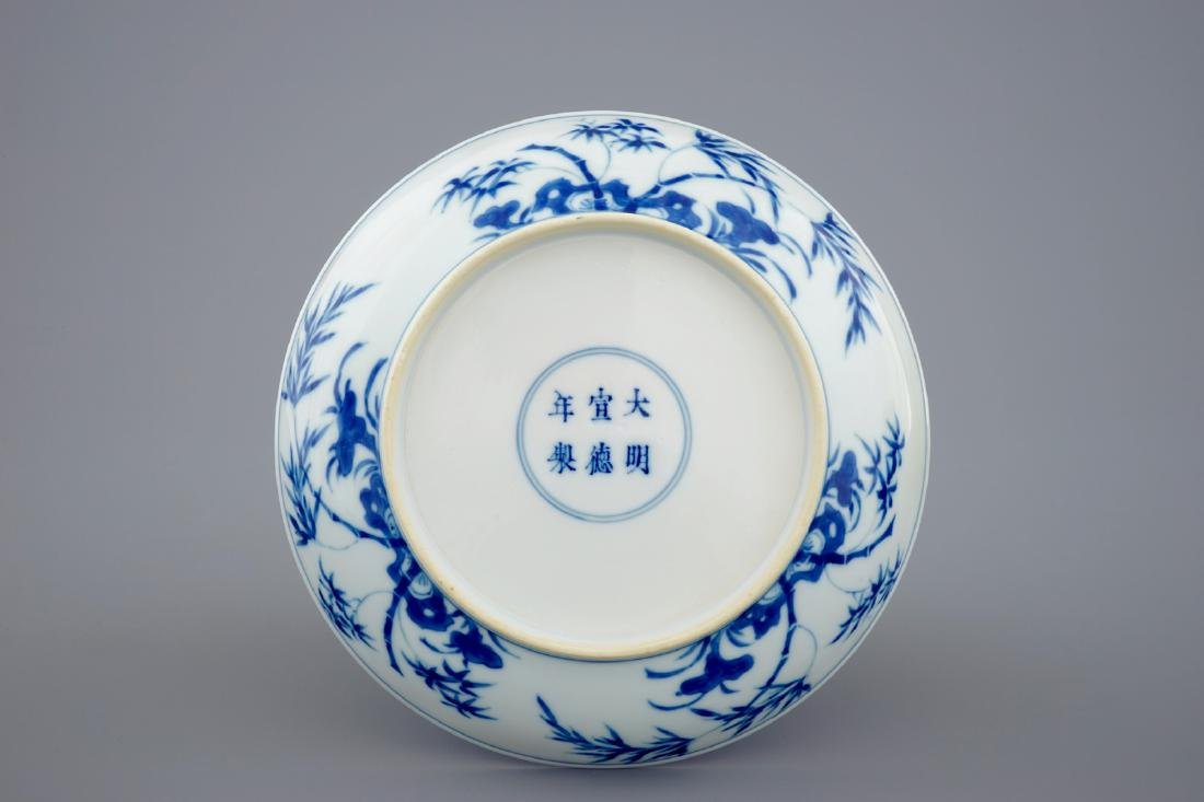 A Chinese blue and white plate with figures in a - 2