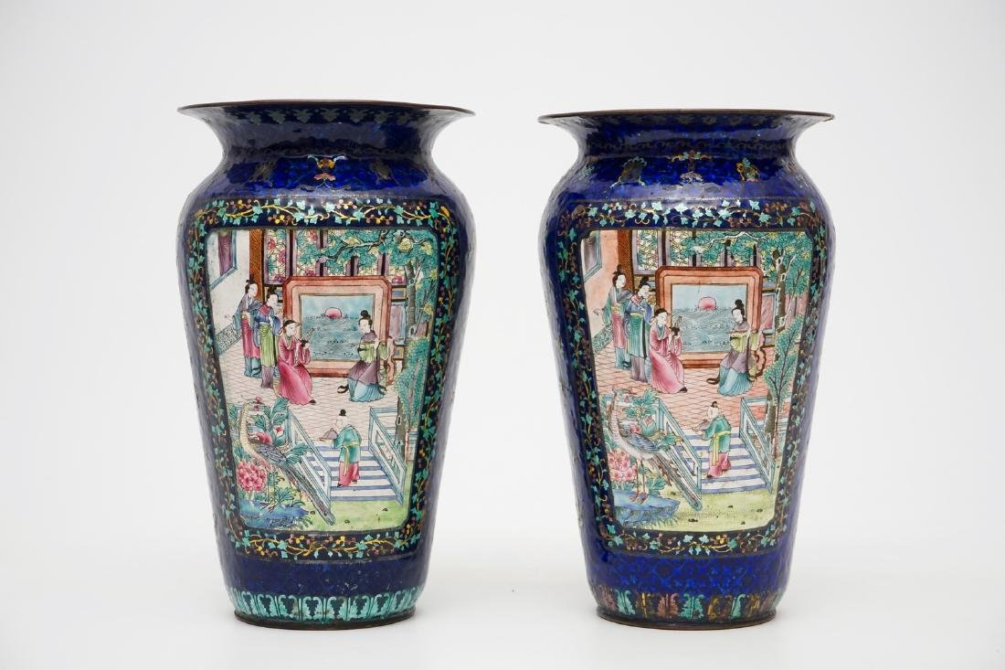 A pair of Chinese blue ground Canton enamel vases, 19th