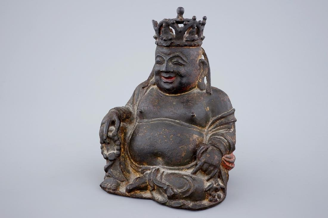 A Chinese gilt and lacquered bronze figure of crowned